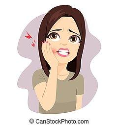 Mujer tocando dolor de muelas