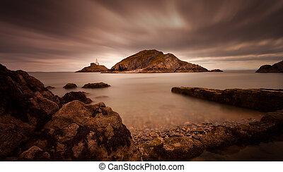 Murmullos de faro Swansea Bay