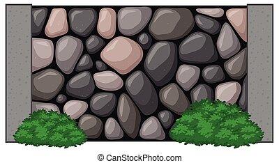 Muro de piedra con arbusto verde