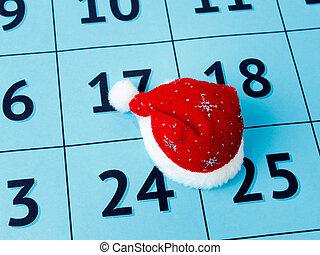 Navidad concepto festivo en el calendario, sombrero de Santa