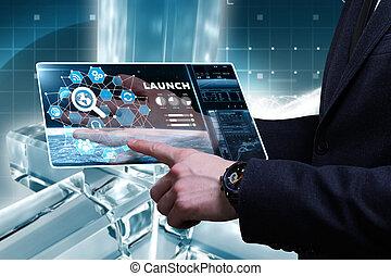 Negocios, tecnología, Internet y el concepto de red. Un joven hombre de negocios trabajando en una pantalla virtual del futuro y ve la inscripción: Lanzamiento