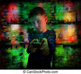 Niño mirando televisión con control remoto