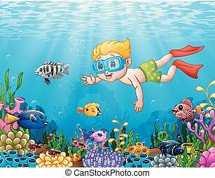Niño pequeño buceando en el mar