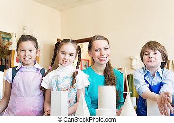 Niños con la maestra