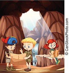 Niños explorando una cueva