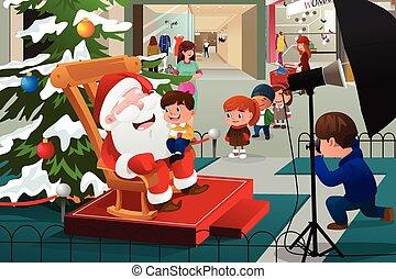 Niños haciendo cola para tomar fotos con Santa Claus