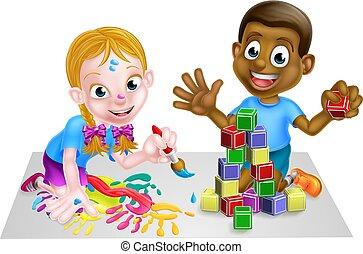 Niños jugando con bloques y pintura