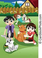 Niños jugando con sus mascotas