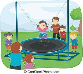 Niños jugando con un trampolín