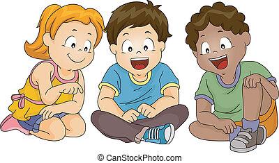 Niños mirando hacia abajo mientras se sientan