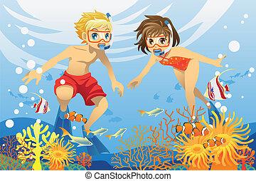 Niños nadando bajo el agua