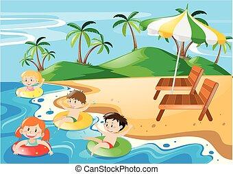 Niños nadando en el océano de día