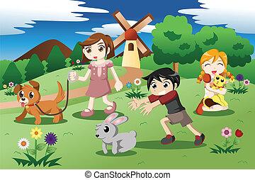 Niños pequeños con mascotas en el jardín