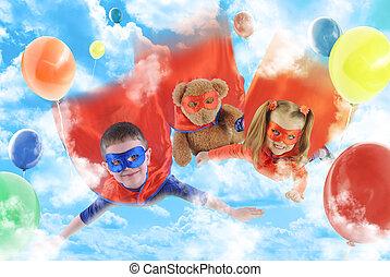 Niños superhéroes volando en el cielo