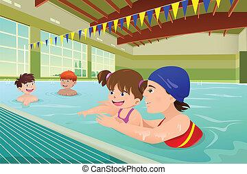 Niños teniendo una lección de natación en la piscina interior