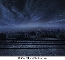 Nubes oscuras sobre fondo urbano