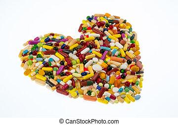 Píldoras coloridas en forma de corazón