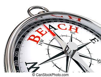 Palabra de playa sobre brújula conceptual