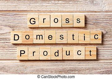 Palabra de producto doméstico bruto escrito en el bloque de madera. El texto GDP sobre la mesa, concepto