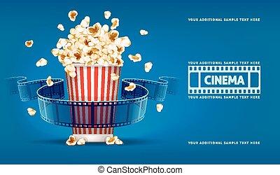 Palomitas de maíz para cine y carrete de cine sobre fondo azul