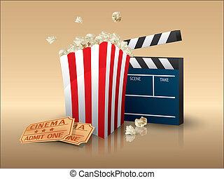 Palomitas de maíz y entradas de cine con tablas de claque
