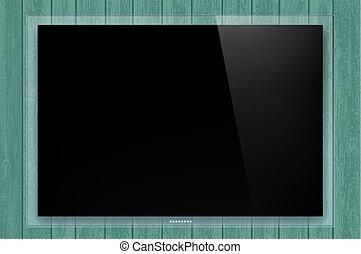 Panel de vidrio negro en la pared de madera.
