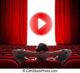 Pantalla de cine en línea con cortina roja abierta y jugar botón de los medios en el centro