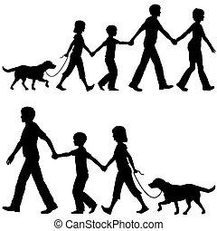 Papá lidera a los niños y al perro caminando