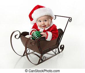 Papá Noel está sentado en un trineo