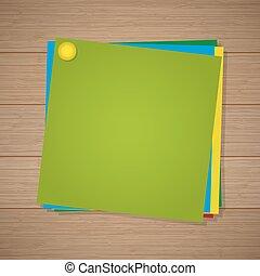 Papel de color para notas con un alfiler en el fondo de madera