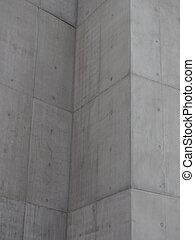 Paredes de hormigón grises con marcas de bloqueo y esquinas en ángulo