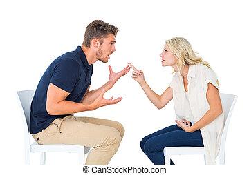 pareja, discusión, sillas, joven, sentado