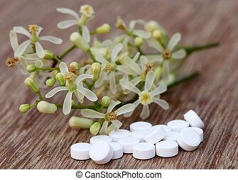 Pastillas hechas de flor medicinal neem