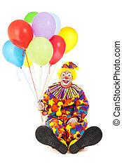 Payaso con pies grandes y globos