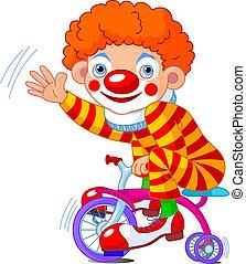 Payaso en bicicleta de tres ruedas