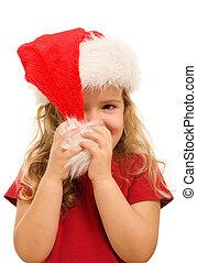 Pequeña chica jugando con sombrero de Navidad