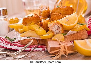 Pescado con patatas.