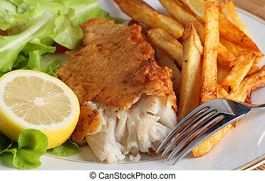 Pescado, papas fritas y ensalada