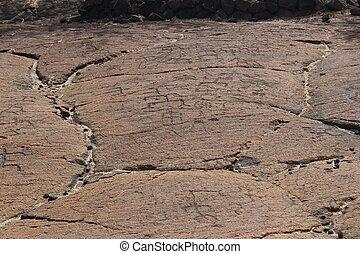 Petroglifos hawaianos nativos en lava