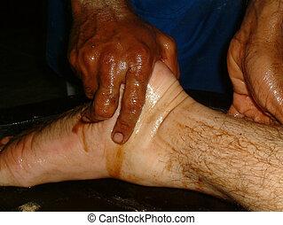 Pie de masaje de aceite