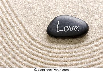 Piedra negra con la inscripción Amor