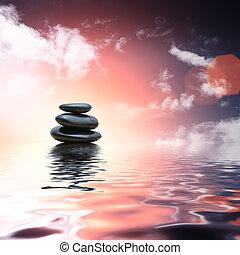 Piedras Zen reflejando en el fondo del agua
