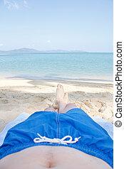 Piernas en la playa