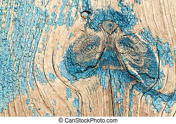 Pintura azul descolorida en la superficie de la madera