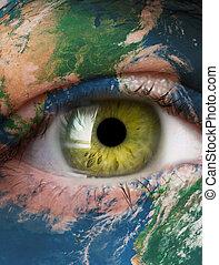 Planeta Tierra y ojo humano verde