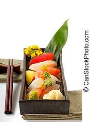 Plata de sushi japonés con chuletas