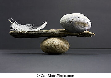 pluma, balance, piedra