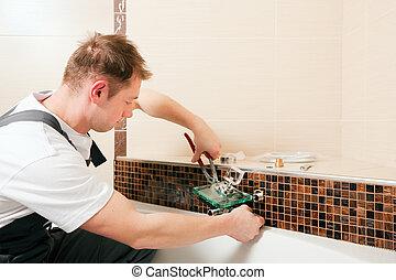 Plumber instalando un grifo en el baño