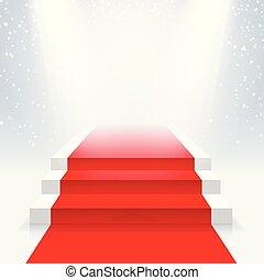 Podio con una alfombra roja en la iluminación de las luces de los reflectores.