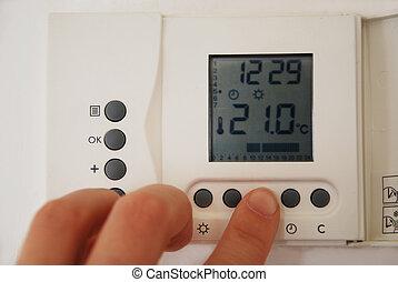 Poniendo la temperatura del termostato de calefacción